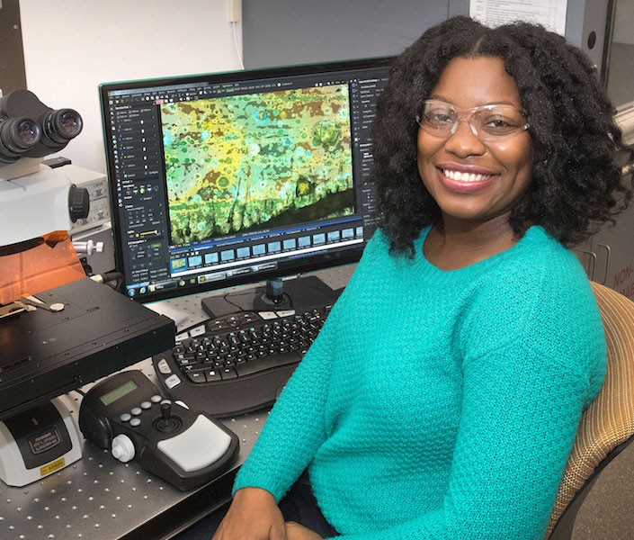 Stony Brook grad student Tiffany Victor uses infrared light to explore how fungal associations help plants thrive